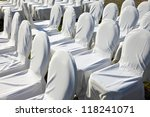 Chairs covered with white cloth, usually used for weddings - stock photo