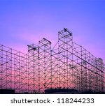 A large stage is being constructed outdoors for a pop festival - stock photo