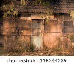 An old wooden shack made from scraps of wood - stock photo