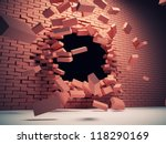 Destruction of brick wall - stock photo