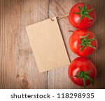 price tag and tomato vegetable at wood background - stock photo