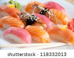 Sushi set on a plate, close-up, studio shot - stock photo