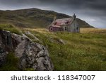 An Old Abandonned Cottage On A...