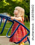 little blonde girl on the playground - stock photo