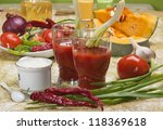 Tomato Juice and group of different vegetables - stock photo