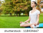 young girl in lotus pose in the ... | Shutterstock . vector #118434667