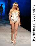 Small photo of Zara Martin on the Agent Provocateur catwalk at the Lingerie London show at Old Bilinsgate Market, London 24/10/2012 Picture by: Steve Vas