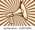 Retro vintage styled megaphone on brown grunge rayburst background - stock vector