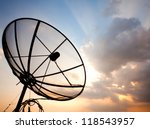 Big telecommunication satellite dish over sunset sky - stock photo
