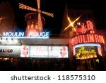 PARIS - SEPTEMBER 23: Advertising cabaret show on facade of Moulin Rouge, famous cabaret and theater on September 23, 2008 in Paris, France - stock photo