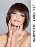 beautiful happy young woman wearing short bob hairstyle on studio background - stock photo