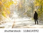 woman walking in colorful snowy forest - stock photo