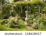 Stock photo english country rose garden with sundial 118618417
