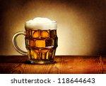 beer mug on rustic wooden table | Shutterstock . vector #118644643