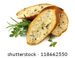 Garlic bread with herbs, isolated on white. - stock photo
