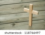 wooden cross on wood background | Shutterstock . vector #118766497
