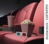 Popcorn, soda and 3D glasses on the seat, ready for the film. - stock photo