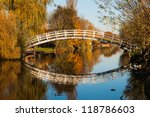 Curved Wooden Bridge Over A...
