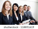Successful businesswoman in group of business people - stock photo
