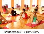 women practicing yoga at health ... | Shutterstock . vector #118906897