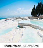 Travertine pools and terraces in Pamukkale Turkey - stock photo