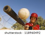 Batter Hitting Softball - stock photo