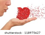 Woman Blowing A Heart Made Of...
