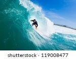 surfer riding large blue ocean... | Shutterstock . vector #119008477