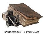 The old Christian Bible near the ancient camera. Isolated on the white - stock photo