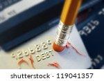 pencil erasing credit card debt | Shutterstock . vector #119041357