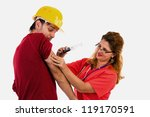 Female doctor/ nurse  putting a syringe to a scared worker on white - stock photo
