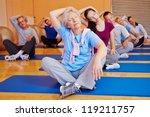 Постер, плакат: Group doing stretching exercises