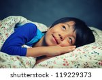 happy asian boy lying in bed... | Shutterstock . vector #119229373