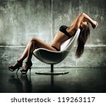 young sexy woman sitting on... | Shutterstock . vector #119263117