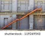 Abandoned building showing rust and decay from weather and the environment - stock photo