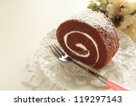 gourmet dessert, swiss roll on white background with copy space - stock photo