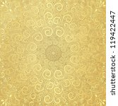 Old yellow paper with round gold lacy pattern - stock photo