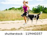 Woman Runner Running With Dog...