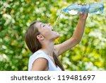 beautiful young woman drinks... | Shutterstock . vector #119481697