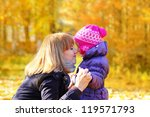 Mother and daughter sharing a moment in the park - stock photo