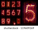 The real Nixie tube indicator a set of decimal digits. - stock photo