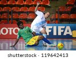 Small photo of BANGKOK,THAILAND-NOV 09:James Egeta of Solomon Islands (green) in actionl during the FIFA Futsal World Cup between Solomon Islands and Guatemala at Indoor Stadium Huamark on Nov9,2012 in,Thailand.