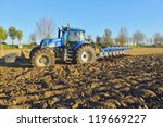 tractor plowing the field | Shutterstock . vector #119669227