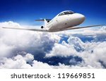 Private jet plane in the blue sky - stock photo