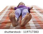Little Girl Lying On A Bed  ...