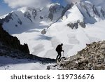 Climber on the way to Aktash summit, Pamir-alay, Kyrgyzstan - stock photo