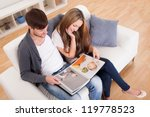 they look at family photo album ... | Shutterstock . vector #119778523