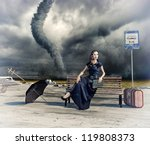 woman,waiting a bus and tornado (photo and hand-drawing elements compilation) - stock photo