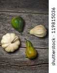 Organic squashes on a rustic wooden board - stock photo
