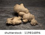 Organic ginger on a rustic wooden board - stock photo